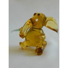 Статуэтка стекло Слон с едой желтый
